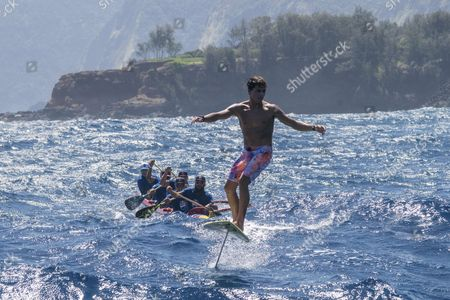 Kai Lenny performs a hydrofoil demo at Downwind Voyage for Change in Hawaii, USA