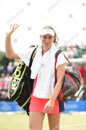 Johanna Konta of Great Britain waves to the crowd after winning the Women's first round match of the Aegon Open against Tara Moore of Great Britain
