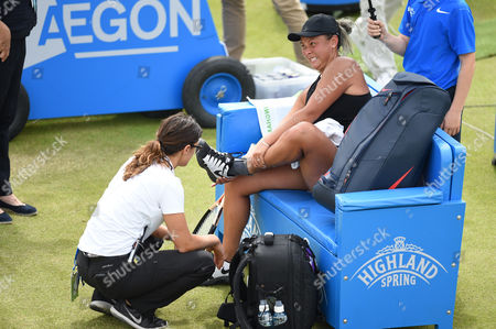 Tara Moore of Great Britain receives treatment during the Women's first round match of the Aegon Open against Johanna Konta of Great Britain
