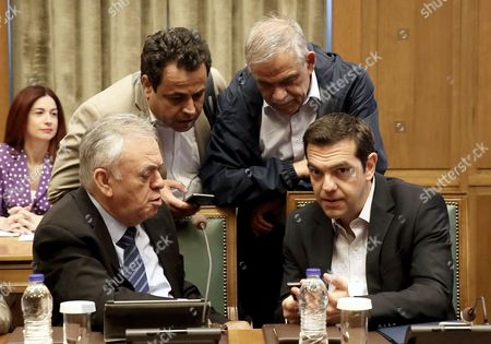 Greek Prime Minister Alexis Tsipras (R) talks with the Vice President of the government Giannis Dragasakis (L), Alternate Minister of Citizens Protection Nikos Toskas (R, background) and Deputy Shipping Minister Nektarios Santorinios (L, background), during a cabinet meeting in the Parliament in Athens, Greece, 13 June 2017. The cabinet meeting is focussing on the Greek approach to a 15 June Eurogroup meeting.
