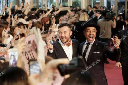"""Giancarlo Esposito, Daniel Henshall Actor Daniel Henshall, left, and Giancarlo Esposito pose during a promotional event for their latest film """"Okja"""" in Seoul, South Korea, . The film will be released in South Korea on June 29"""