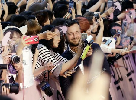 """Actor Daniel Henshall poses with fans for a photograph during a promotional event for his latest film """"Okja"""" in Seoul, South Korea, . The film will be released in South Korea on June 29"""