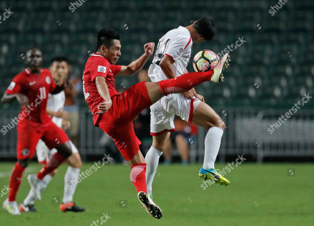 Lee Chi Ho, Kang Kuk-chol Hong Kong's Lee Chi Ho, left, fights for the ball against North Korea's Kang Kuk-chol, right, during the AFC Asian Cup 2019 qualification soccer match in Hong Kong