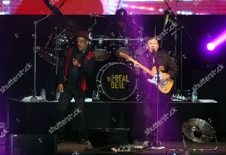 Terence Wilson and Ali Campbell of UB40 plays the guitar on stage