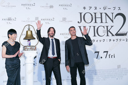 (L to R) Japanese singer Akiko Wada, actor Keanu Reeves and director Chad Stahelski pose for cameras