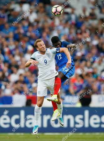 England's Harry Kane, left, jumps for the ball with France's Samuel Umtiti during a friendly soccer match between France and England at the Stade de France in Saint Denis, north of Paris, France