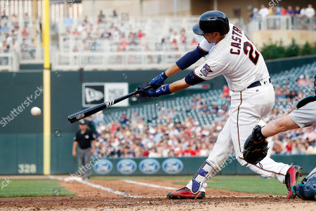 Minnesota Twins' Jason Castro hits an RBI single off Seattle Mariners starting pitcher Christian Bergman in the third inning of a baseball game, in Minneapolis