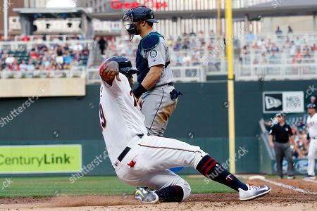 Kennys Vargas, Mike Zunino Minnesota Twins' Kennys Vargas, left, scores past Seattle Mariners catcher Mike Zunino on an RBI single by Jason Castro off Seattle Mariners starting pitcher Christian Bergman in the third inning of a baseball game, in Minneapolis
