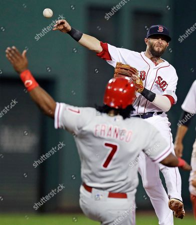 Stock Image of Maikel Franco, Dustin Pedrioa Philadelphia Phillies' Maikel Franco (7) slides high after being forced, as Boston Red Sox second baseman Dustin Pedroia, top, throws to first during the sixth inning of a baseball game at Fenway Park in Boston,. Michael Saunders was safe at first, and Tommy Joseph scored on the play