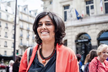 Myriam El Khomri former Labour minister and French socialist Party (PS) candidate for the upcoming legislative elections in the 18th district of Paris, hands out campaign leaflets.