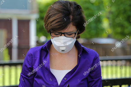 BBC news reporter Jane Hill with face mask. Smoke billows from Grenfell Tower after a fire engulfed the block in west London. The massive fire ripped through the 24-storey apartment block in the early hours of Wednesday, trapping residents inside as 200 firefighters battled the blaze. Police and fire services attempted to evacuate the concrete block and said 'a number of people are being treated for a range of injuries', including at least two for smoke inhalation.
