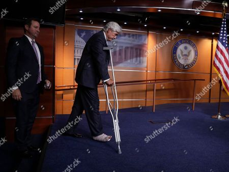 Rep. Roger Williams, R-Texas, who was wounded during a shooting at a congressional baseball practice in Alexandria, Va., arrives on crutches for a news conference on Capitol Hill in Washington