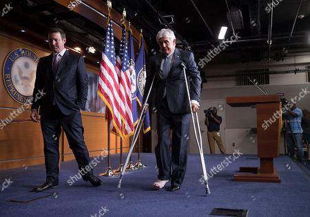 Roger Williams, J. Spencer Freebairn Rep. Roger Williams, R-Texas, who injured his ankle during a shooting at a congressional baseball game practice, leaves a news conference on crutches, assisted by his aide J. Spencer Freebairn, left, at the Capitol in Washington