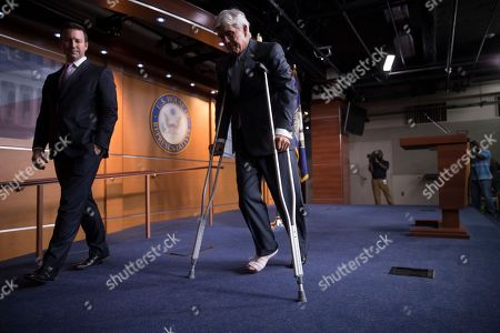 Roger Williams, J. Spencer Freebairn Rep. Roger Williams, R-Texas, who injured his ankle during a shooting at a practice for a congressional baseball game in Alexandria, Va., leaves a news conference on crutches, assisted by his aide J. Spencer Freebairn, left, at the Capitol in Washington