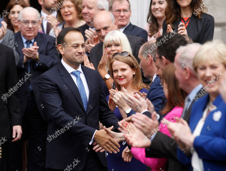 Ireland's new Prime Minister Leo Varadkar is congratulated by lawmakers after being elected Ireland's 14th Taoiseach (Prime Minister) at Leinster House, Dublin, Ireland,. Varadkar defeated rival Simon Coveney in a contest to replace Enda Kenny, who resigned last month