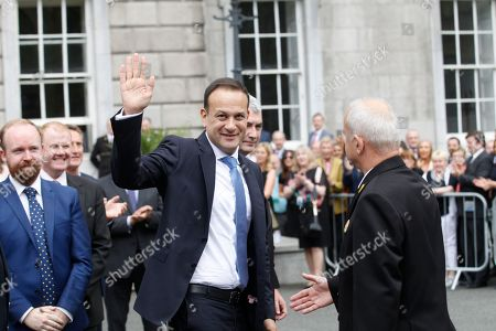 Ireland's new Prime Minister Leo Varadkar waves to the media after being elected Ireland's 14th Taoiseach (Prime Minister) at Leinster House, Dublin, Ireland,. Varadkar defeated rival Simon Coveney in a contest to replace Enda Kenny, who resigned last month