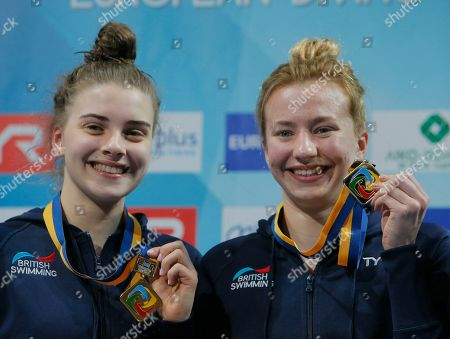 Phoebe Banks, Ruby Bower Britain's Phoebe Banks, right, and Ruby Bower hold up their gold medals after winning in the women's 10m synchro platform final at the European Diving Championship in Kiev, Ukraine