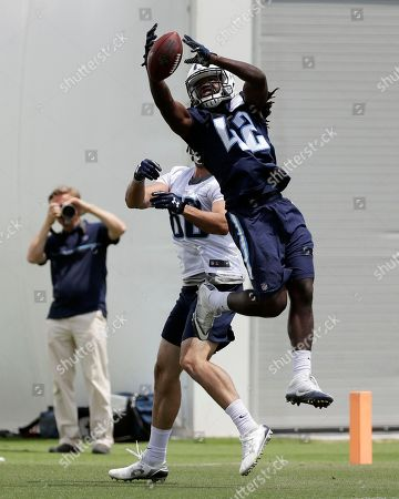 Denzel Johnson, Jace Amaro Tennessee Titans safety Denzel Johnson (42) blocks a pass intended for tight end Jace Amaro (88) during NFL football minicamp, in Nashville, Tenn