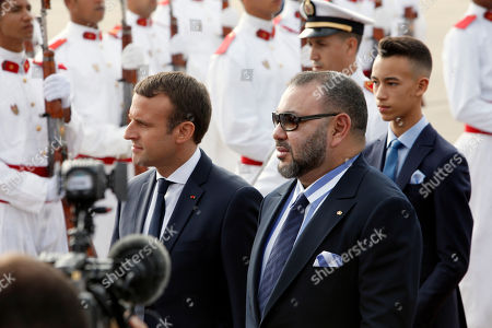 Morocco's King Mohammed VI, second right, followed by by his son Crown Prince Moulay El Hassan, right, welcomes French President Emmanuel Macron, left, upon his arrival at Rabat airport, Morocco, . The visit is the first by the recently elected French president to a North African country and aims to strengthen the relationship between France and Morocco, including cooperation on security issues