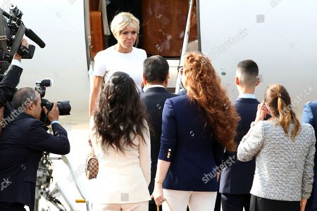 French first lady Brigitte Macron is welcomed by Morocco's Princess Lalla Salma, wife of King Mohammed VI, center, and their son Crown Prince Moulay El Hassan, second right, upon the arrival of French President Emmanuel Macron, at Rabat airport, Morocco, . The visit is the first by the recently elected French president to a North African country and aims to strengthen the relationship between France and Morocco, including cooperation on security issues