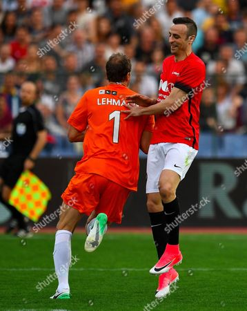Dimitar Berbatov (R) of the United Stars team joaks with goalkeeper Jens Lehmann of the All Stars team during the charity soccer match All Stars 2017 at Vassil Levski stadium in Sofia, Bulgaria, 14 June 2017. The charity event All Stars 2017 is organized by the Dimitar Berbatov foundation and with the help of Portuguese soccer legend Luis Figo to help children in Bulgaria.