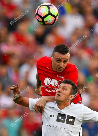 Dimitar Berbatov (up) of United Stars team  vies for the ball with Dimas of All Stars team during the charity soccer match All Stars 2017 at Vassil Levski stadium in Sofia, Bulgaria, 14 June 2017. The charity event All Stars 2017 is organized by the Dimitar Berbatov foundation and with the help of Portuguese soccer legend Luis Figo to help children in Bulgaria.