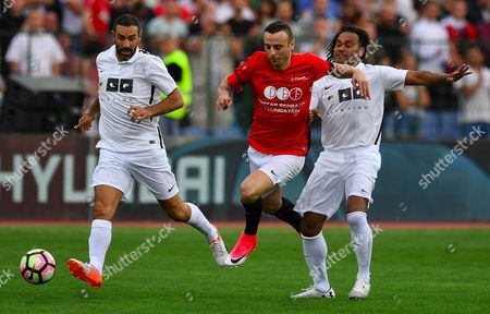 Dimitar Berbatov (C) of United Stars team  fights for the ball with Christian Karembeu (R) and Robert Pires of All Stars team during the charity soccer match All Stars 2017 at Vassil Levski stadium in Sofia, Bulgaria, 14 June 2017. The charity event All Stars 2017 is organized by the Dimitar Berbatov foundation and with the help of Portuguese soccer legend Luis Figo to help children in Bulgaria.