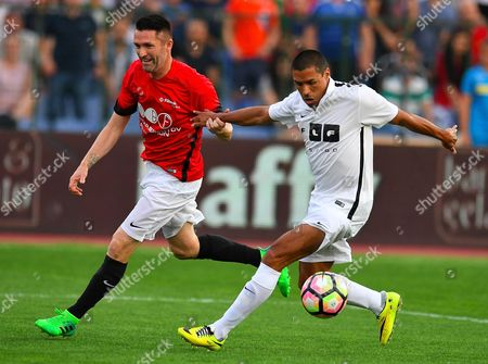 Robert Keane (L) of United Stars team vies for the ball with Ivan Cordoba of All Stars team during the charity soccer match All Stars 2017 at Vassil Levski stadium in Sofia, Bulgaria, 14 June 2017. The charity event All Stars 2017 is organized by the Dimitar Berbatov foundation and with the help of Portuguese soccer legend Luis Figo to help children in Bulgaria.