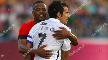Patrice Evra (L) of United Stars team hugs  Luis Figo of All Stars team during the charity soccer match All Stars 2017 at Vassil Levski stadium in Sofia, Bulgaria, 14 June 2017. The charity event All Stars 2017 is organized by the Dimitar Berbatov foundation and with the help of Portuguese soccer legend Luis Figo to help children in Bulgaria.