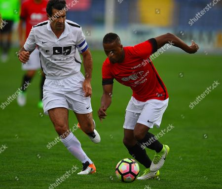 Patrice Evra (R) of United Stars team vies for the ball with Luis Figo of All Stars team during the charity soccer match All Stars 2017 at Vassil Levski stadium in Sofia, Bulgaria, 14 June 2017. The charity event All Stars 2017 is organized by the Dimitar Berbatov foundation and with the help of Portuguese soccer legend Luis Figo to help children in Bulgaria.