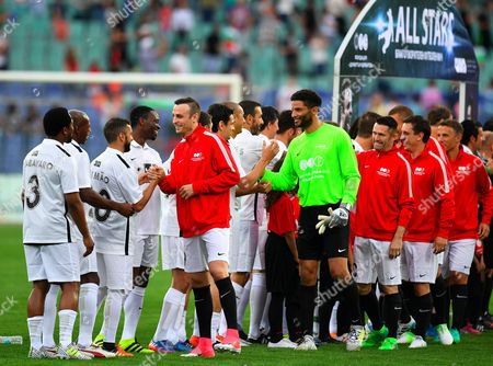 Players of the United Stars team of Dimitar Berbatov welcome the team of All Star during the charity soccer match All Stars 2017 at Vassil Levski stadium in Sofia, Bulgaria, 14 June 2017. The charity event All Stars 2017 is organized by the Dimitar Berbatov foundation and with the help of Portuguese soccer legend Luis Figo to help children in Bulgaria.