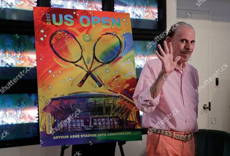 Stock Image of Artist Peter Max acknowledges applause during the unveiling of the theme art he created for the 2017 U.S. Open tennis tournament, in New York. Max also created the theme art first featuring Arthur Ashe Stadium when it was brand new 20 years ago