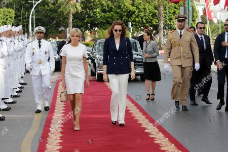 French first lady Brigitte Macron, center left, and Morocco's Princess Lalla Salma, wife of King Mohammed VI, arrive at the National Museum of Contemporary Arts of Rabat to visit the Picasso exhibition in Rabat, Morocco, . French President Emmanuel Macron is in his first visit to a North African country and aims to strengthen the relationship between France and Morocco, including cooperation on security issues