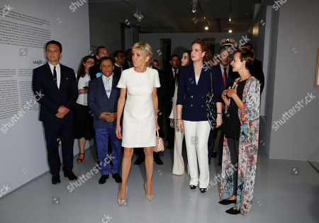 Morocco's Princess Lalla Salma, wife of King Mohammed VI, center right, and French first lady Brigitte Macron, center left, visit the Picasso exhibition at the National Museum of Contemporary Arts of Rabat in Rabat, Morocco
