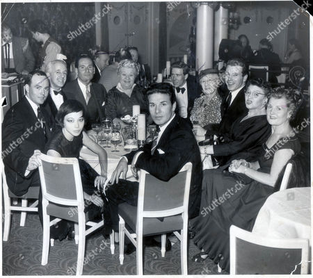 Stock Image of Lord Snowdon Before Marriage 1958 Earl Of Snowdon Its Party Night For Tony Armstrong-jones And The Theatre People Among Whom He First Made His Name As A Photographer Are Prominent At His Table In The Cafe De Paris. It Was A Birthday Party Held Just Two Yars Ago And Sophie Tucker And Suzie Wong Star Jackie Chan Are There. Others At The Table From Left To Right Are Steven Benedict Major Neville Willing (see His Article In The Sunday Dispatch Today) Lawyer David Jacobs And John Barr.