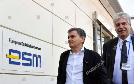 Greek Finance Minister Euclid Tsakalotos, left, and Austrian Finance Minister Hans Joerg Schelling arrive for a meeting at the office of the European Stability Mechanism in Luxembourg on . Eurogroup finance ministers meet later on Thursday to review the bailout program for Greece