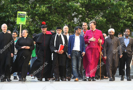 Stock Picture of (Left to Right/Front) The Dean of St Pauls, The Very Reverend David Ison ; Canon Tricia Hillas of St Pauls; Reverend Alan Green of Bethnal Green; Dr Sheikh Ramzy, Director Oxford Islam Centre; Jehangir Malik, CEO of Muslim Aid; Bishop of Fulham, Jonathan Baker