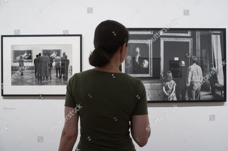 Stock Picture of A visitor looks at images during a press preview of the exhibition showcasing the photos taken by American photographer Elliott Erwitt during his visit to Hungary in 1964 in Mai Mano House of Hungarian Photographers in Budapest, Hungary, 15 June 2017.