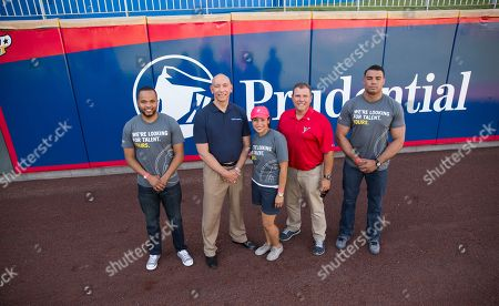 From left, Shelton Kelley, Army Veteran and manager at Prudential, Charles Sevola, head of Prudential's Office of Veterans Initiatives, Patricia Perez, executive assistant at Prudential, Brad Taylor, GM for the El Paso Chihuahuas, and Scott Anderson, Army Veteran and student in the Workforce Opportunity Services Program with Prudential, stand for a photo before the start of El Paso Chihuahuas AAA baseball game at Southwest University Park on in El Paso, Texas