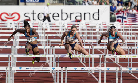First placed Pamela Dutkiewicz (GER), left, together with thrid placed Isabelle Pedersen (NOR) and second placed Kristi Castlin (USA) in the womens 100m hurdles at the Golden League Bislett Games in Oslo, Norway, 15 June 2017.