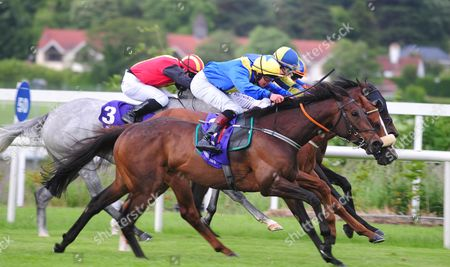 LEOPARDSTOWN. POITIN and Robbie Downey (near) beats off RUMMAGING and DE CORONADO for trainer Keith Clarke.