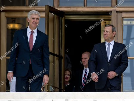 Associate Justice of the Supreme Court of the United States Neil M. Gorsuch and Chief Justice of the United States John G Roberts Jnr