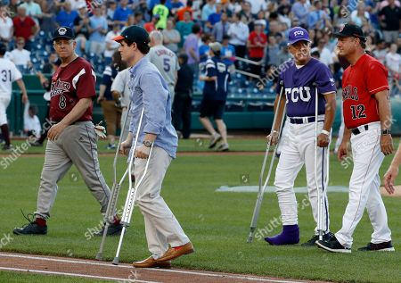 Zach Barth, Roger Williams Injured aide Zach Barth, left, and Rep. Roger Williams, R-Texas, also on crutches walk off the field before the Congressional baseball game, in Washington. The annual GOP-Democrats baseball game raises money for charity