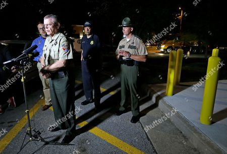 Mark Gwyn, Bill Miller, Mike Fitzhugh, Josh DeVine Rutherford County Sheriff Mike Fitzhugh, front, speaks during a news conference held at a truck stop, in Christiana, Tenn., after authorities arrested Donnie Rowe and Ricky Dubose, two escaped inmates wanted in the slayings of two Georgia prison guards. Officials said a Tennessee homeowner held the two escaped inmates at gunpoint until authorities could arrive and arrest them. From left are Tennessee Bureau of Investigation spokesperson Josh DeVine, Fitzhugh, Tennessee Bureau of Investigation Director Mark Gwyn, and Tennessee Highway Patrol Lt. Bill Miller