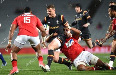 Scott Williams of Wales is tackled by Valentino Mapapalangi of Tonga.