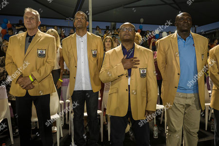 Former NFL players, from left, Joe Montana, Andre Reed, Mike Singletary and Bruce Smith attend a football game in Ramat Hasharon, near Tel Aviv, Israel. 18 members of the Pro Football Hall of Fame who arrived for a weeklong visit to meet some of the 2,000 active players in Israel's various leagues organized by New England Patriots owner Robert Kraft, who has been sponsoring the sport in Israel since it was launched in 1999