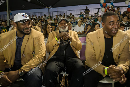 Former NFL players, from left, Jerome Bettis, Jim Brown and Cris Carter attend a football game in Ramat Hasharon, near Tel Aviv, Israel. 18 members of the Pro Football Hall of Fame who arrived for a weeklong visit to meet some of the 2,000 active players in Israel's various leagues organized by New England Patriots owner Robert Kraft, who has been sponsoring the sport in Israel since it was launched in 1999