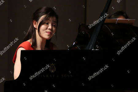Stock Picture of Pianist Sa Chen performs at her solo concert in Shenyang