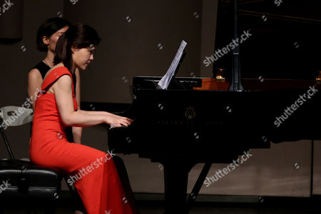 Pianist Sa Chen performs at her solo concert in Shenyang