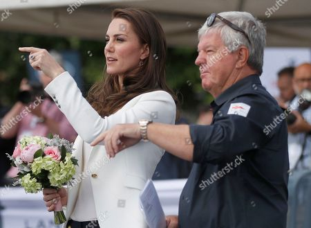 Catherine Duchess of Cambridge, left, Patron of the 1851 Trust, is welcomed by Keith Mills as she arrives to attend the charity's final Land Rover BAR Roadshow at the Docklands Sailing and Watersports Centre in London